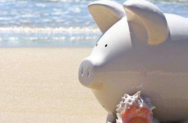 Piggy Bank on a beach, vacation, retirement